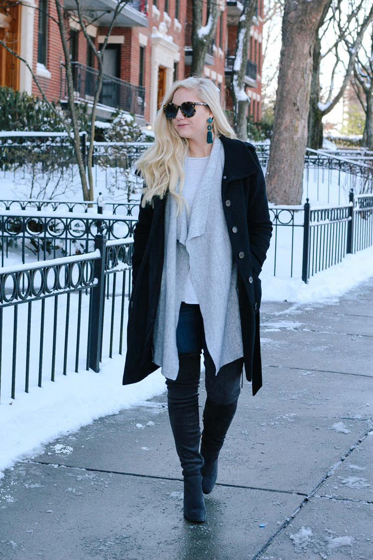 winter style with an oversized vest and over the knee boots